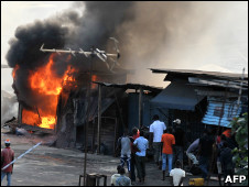 110225170020_stores_on_fire_abidjan_226x170_afp