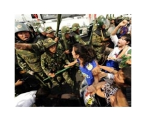 china-urumqi-police-riot-uygur-women-protestors-afp-lg
