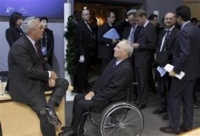 Italian Finance Minister Tremonti  talks to German Finance Minister Schauble at the G20 meeting in Paris